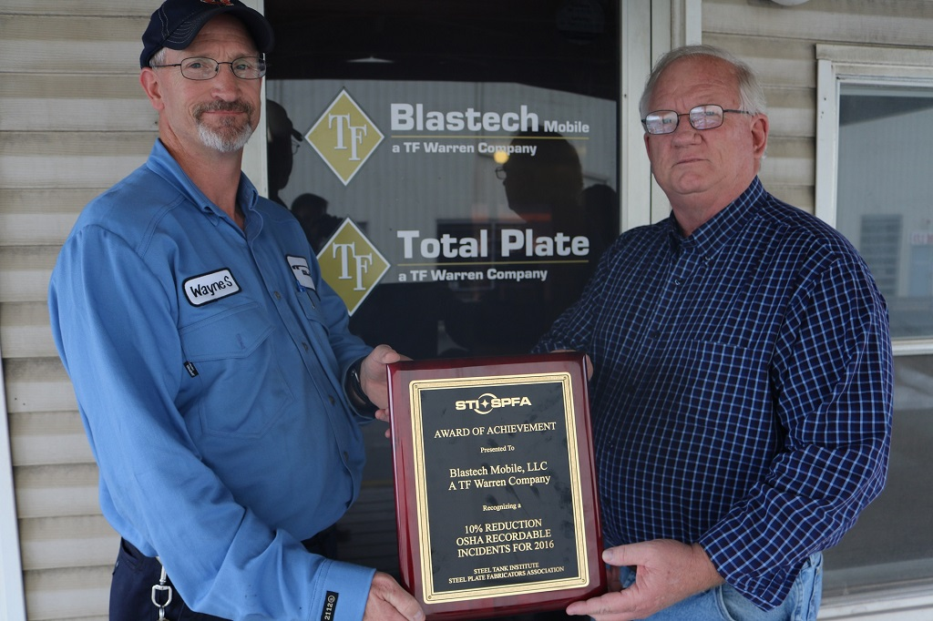 Wayne Smith and Andy Walter with Blastech Mobile holding STI/SPFA Safety Award for 2016